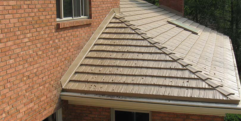 Roofing material and color keep your home comfy colorado for Metal hip roof
