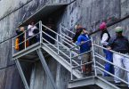 Board members get a close-up look at the outer face of the Morrow Point Dam during their field trip.