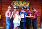Natalie Woodruff poses with the cast at the Great Alaskan Lumberjack Show.