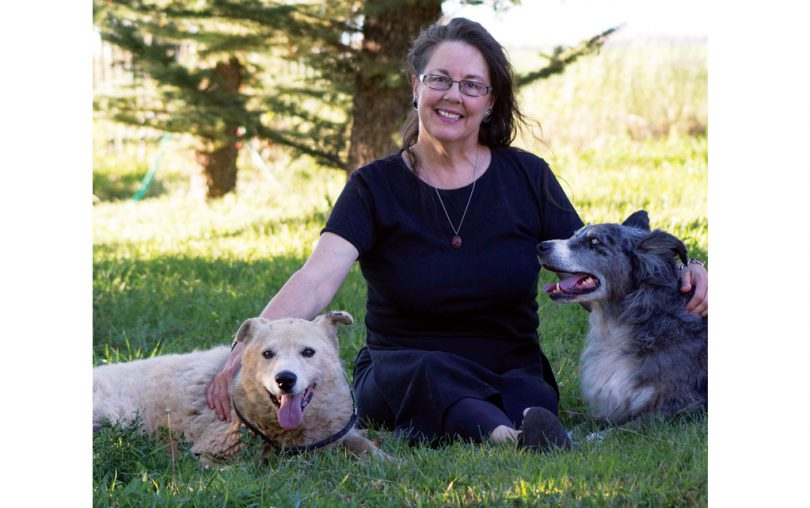 Ruth Wilson shares a moment with her pup Pongo Bobby (left) and her sister's dog Lucky (right), both winners of this month's contest.