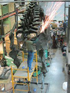 David Livingston welds segments of a Brontosaurus.