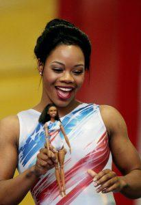 Gabby Douglas with the 2016 Gabby Douglas doll. Photo courtesy of barbiemedia.com.