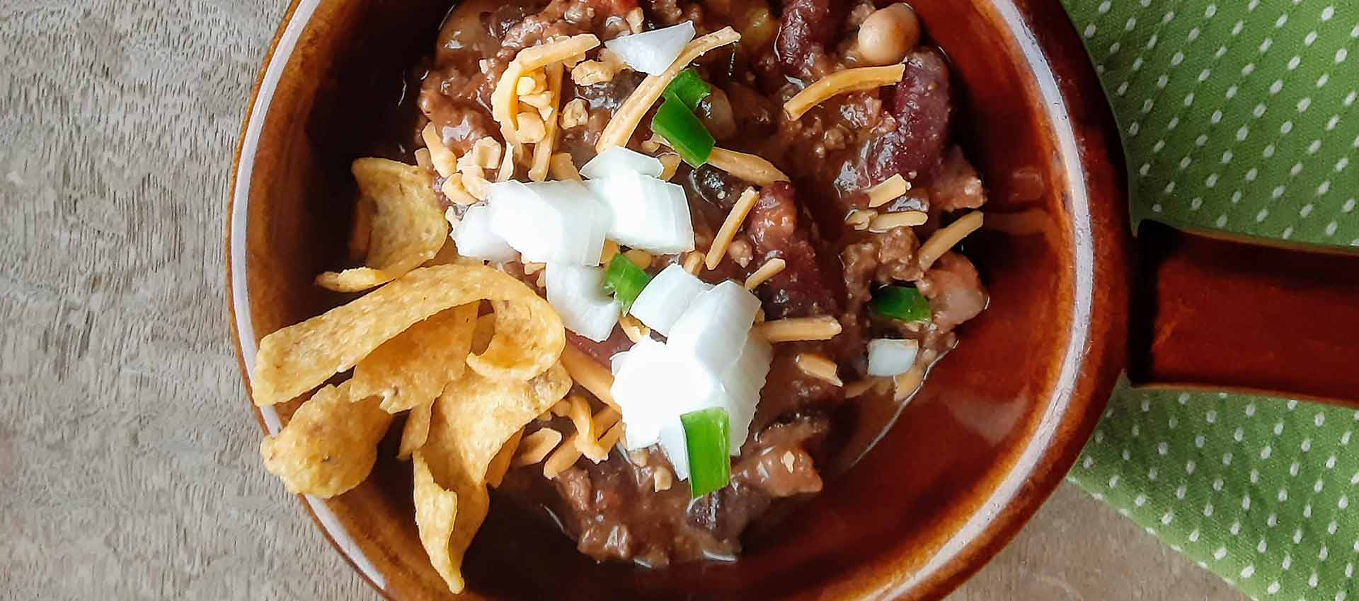 closeup of elk and venison chili in brown bowl