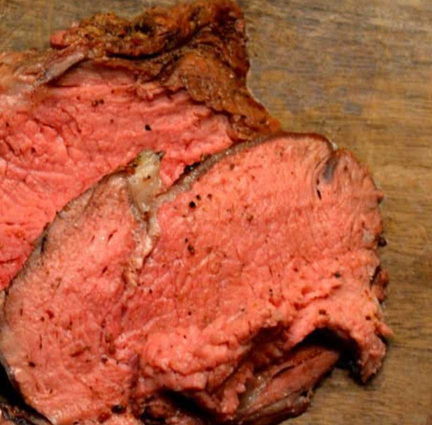 closeup of prime rib on cutting board