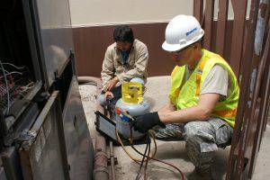 HVAC pros inspecting furnace