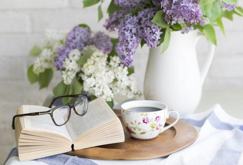 book, glasses, flowers and coffee