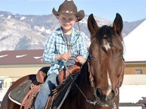 Zack on a horse at Latigo Ranch