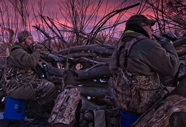 two hunters use their duck whistles as the sun begins to rise