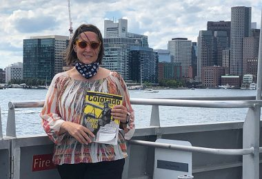 electric co-op winner with her magazine on a ferry in Massachusetts