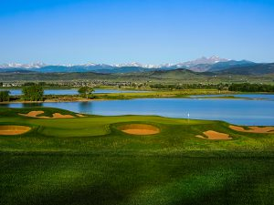 The TPC Colorado course with a lake and the Rockies in the background