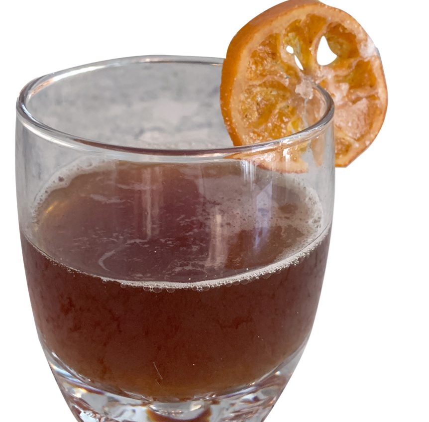 Old fashioned mocktail with a candied orange slice